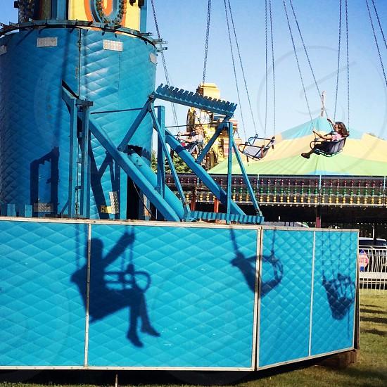 woman riding a blue swing ride photo