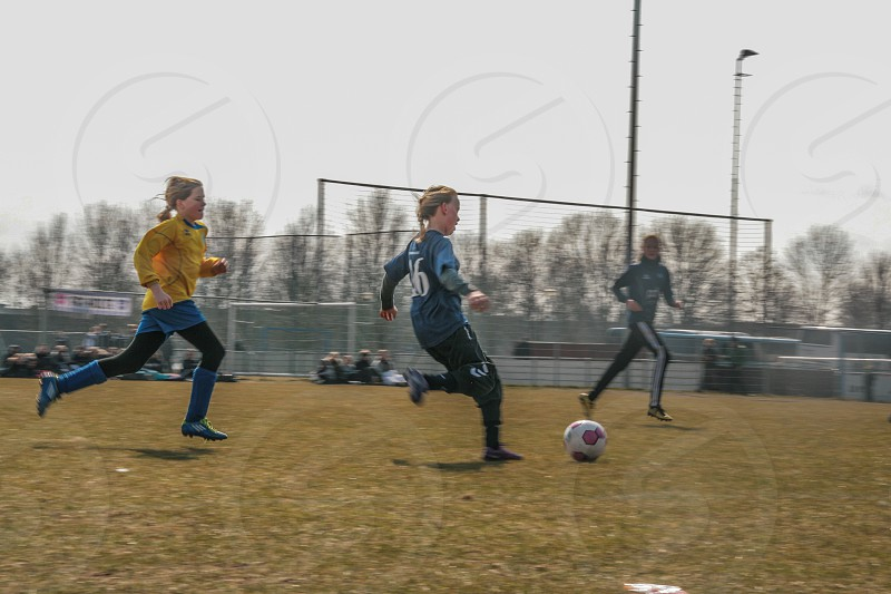 young girls playing a soccergame photo