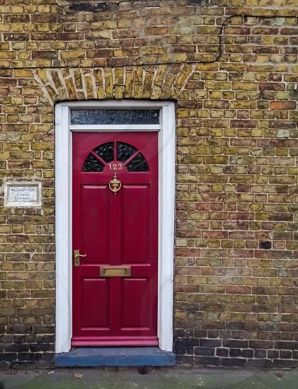 Vintage retro old fashion door house home brickwork red brass handle door knocker photo