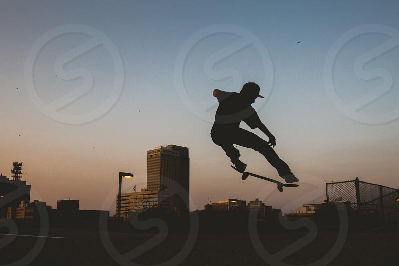 Skateboarding. Ollie. Sports. Action Sports. Action. Silhouette. Skateboard. Skate. Skating.  photo