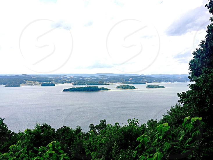rainforest islands between lake during daytime photo
