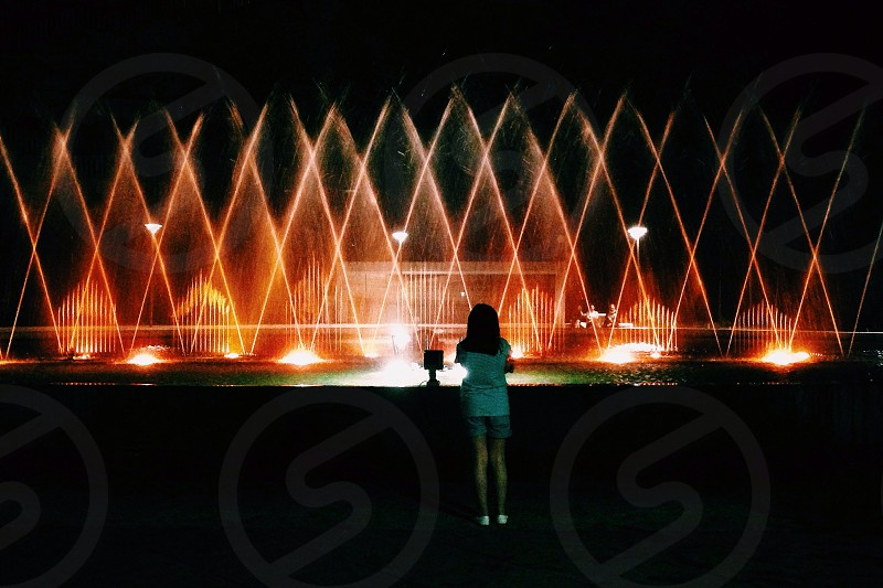 woman in blue blouse and blue short seeing fountain display photo