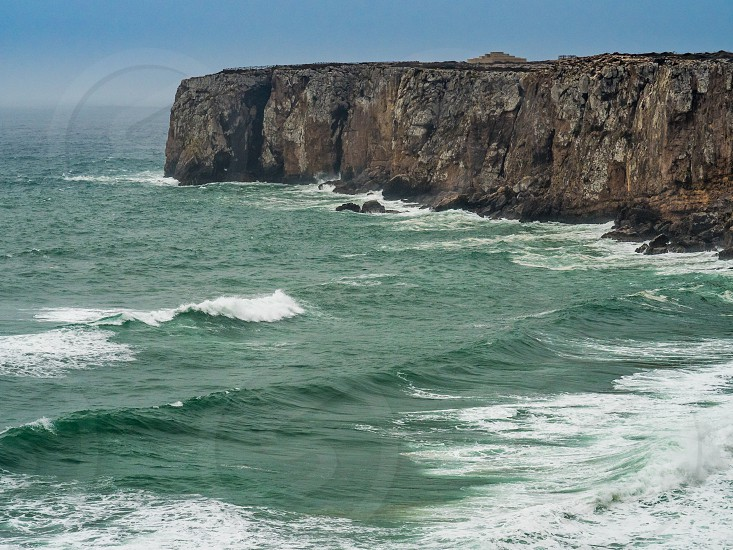 Stormy Atlantic at the most southwestern cape of Europe. Sagres southwest coast of Portugal. photo
