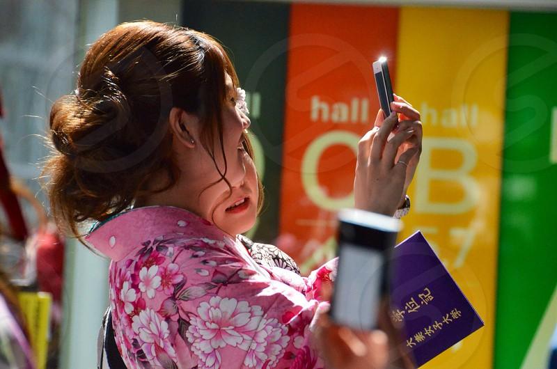 woman holding black smartphone photo
