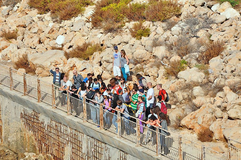 people standing by the railing photo