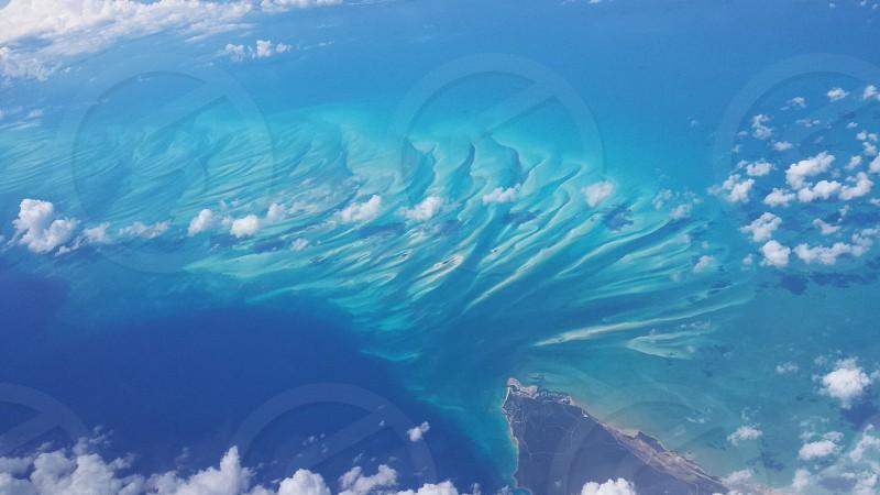 Caribbean ocean aerial 35000 ft. blue waters clouds island photo