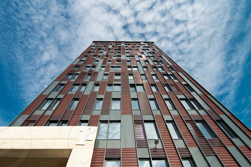 Minimalistic multi storied building on blue sky background  photo