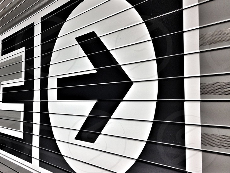 black and white arrow sign photo