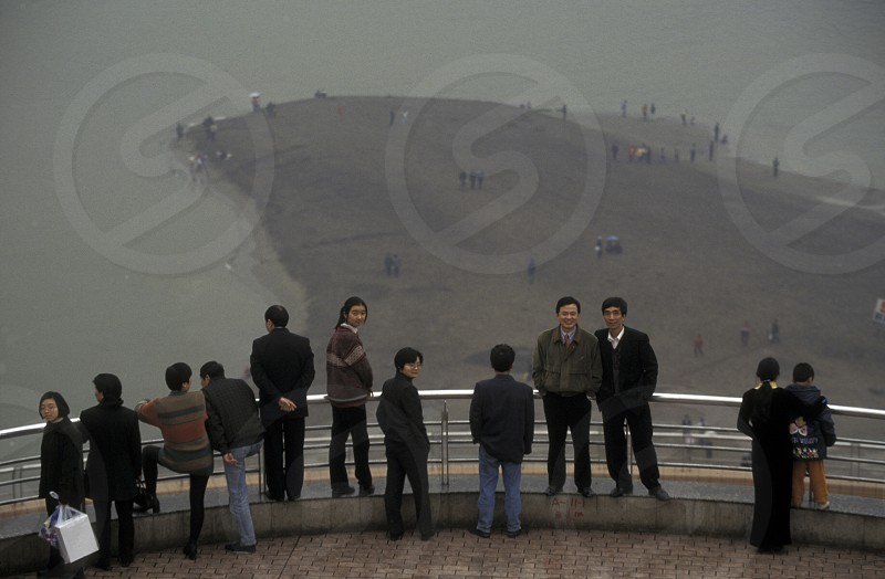 People at the Yangzee river in the city of Chongqing in the province of Sichuan in china in east asia.  photo