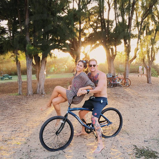 man and woman riding bicycle photo
