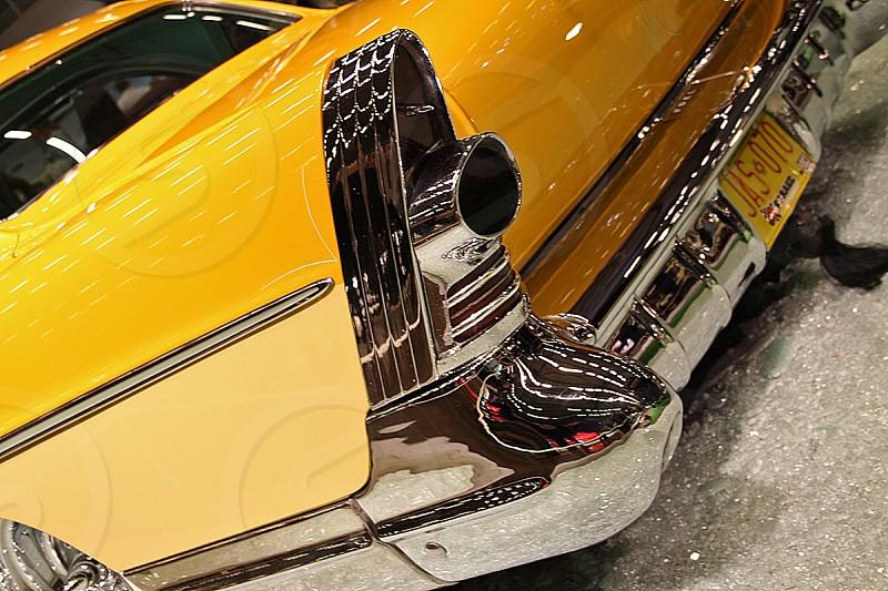 yellow classic car photo