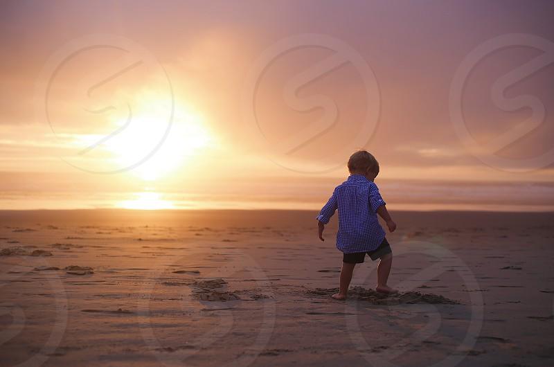 Boy sunset beach play colorful coast summer summertime  photo