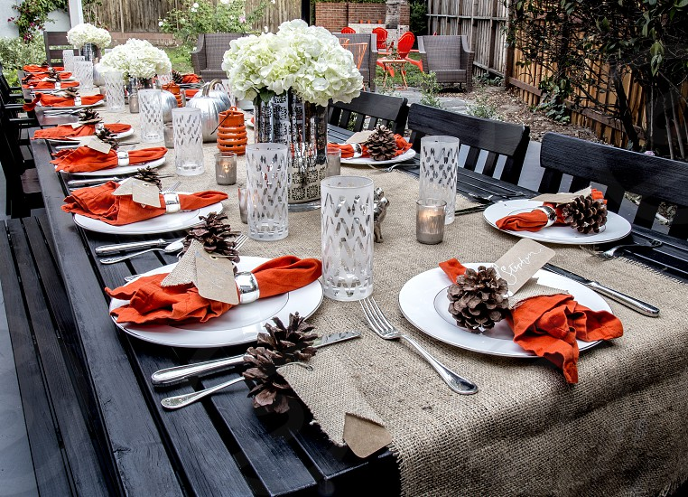 Family table set for outdoors Thanksgiving dinner. photo