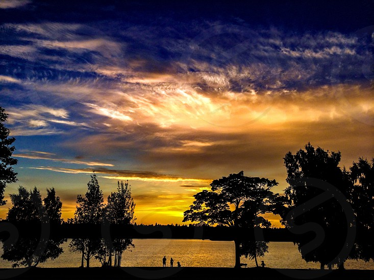 Sunset with trees and lake photo