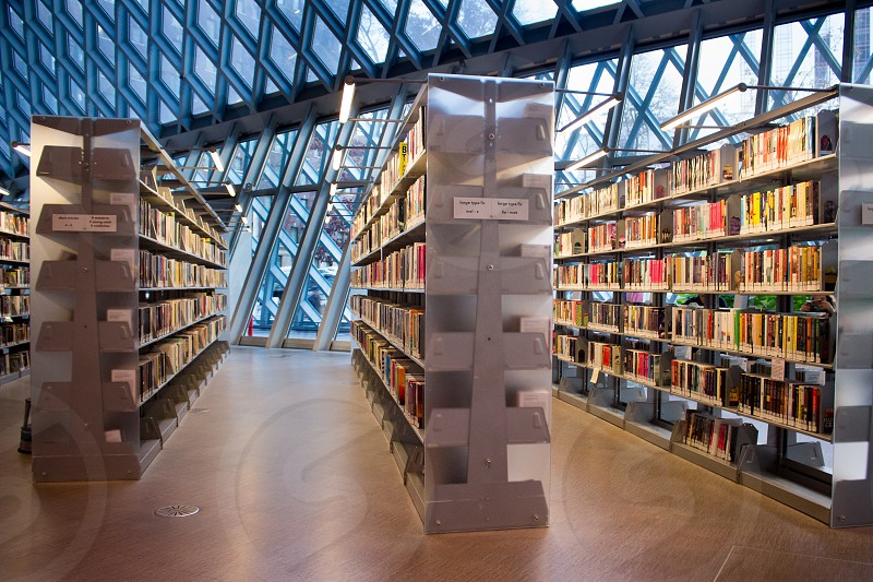 Seattle downtown public library architecture glass a-frame entry books shelves photo