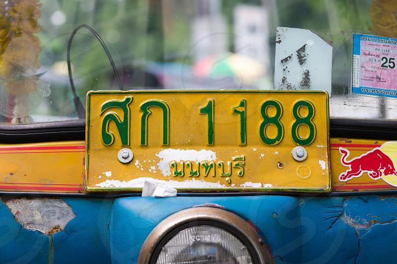 Tuk tuk taxis in Bangkok city.  photo