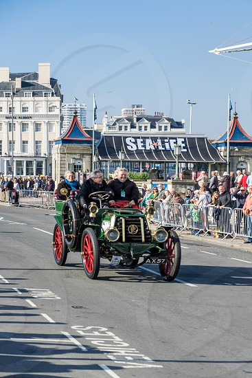 Car approaching the Finish Line of the London to Brighton Veteran Car Run photo