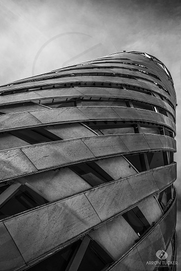 worm's eye view grayscale photography of concrete tower photo