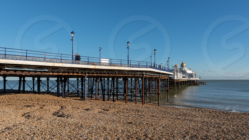 EASTBOURNE EAST SUSSEX/UK - JANUARY 28 : View of Eastbourne Pier in East Sussex on January 28 2019. Two unidentified people. photo