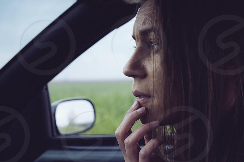 Sad woman in car photo