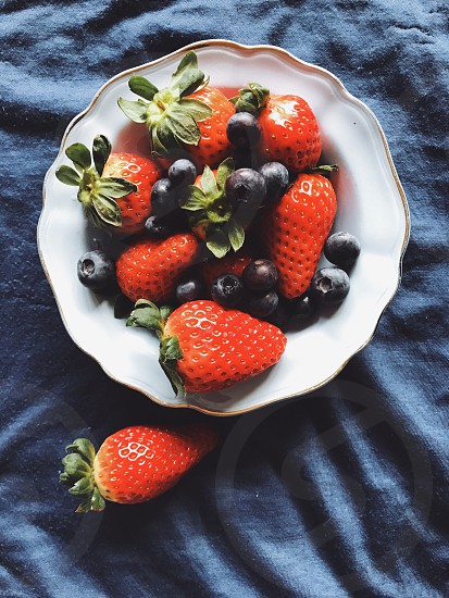 Strawberries  blueberries  plate bowl freshness fresh berries top view top perspective  right above harvest vitamins  photo