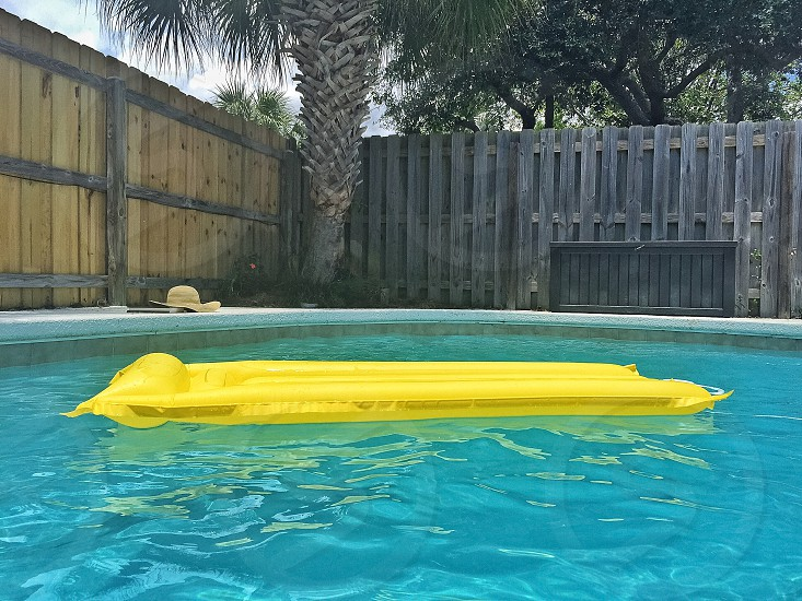 Pop of yellow in the pool photo