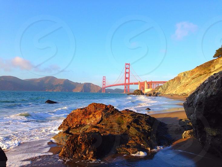 rocky shore near the red bridge photo
