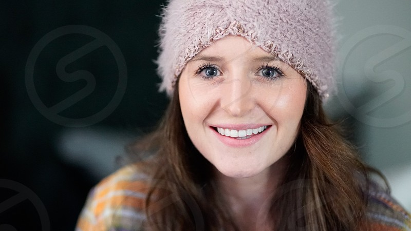 Girl smiling beanie  photo