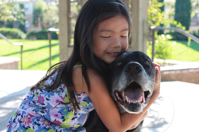 Happiness of child and her dog photo