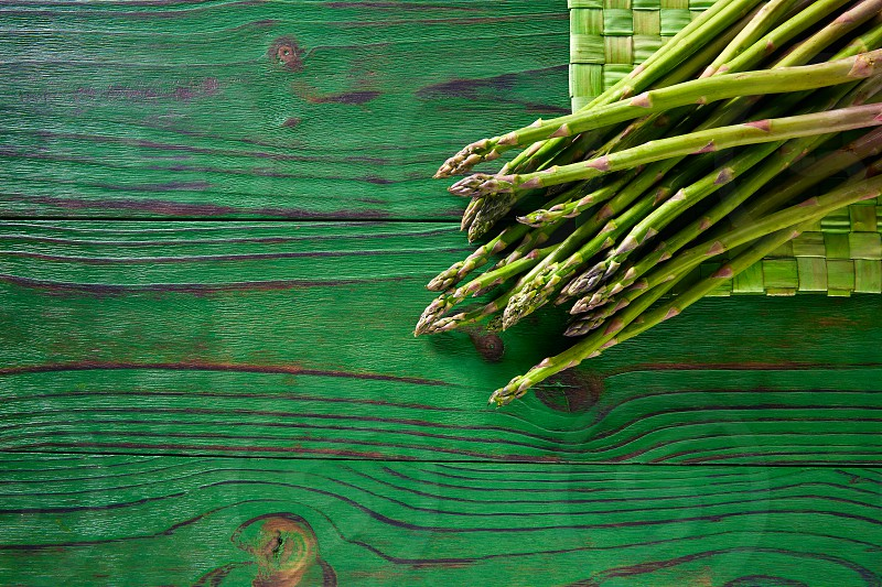 green asparagus fresh on wooden monochrome rustic table photo