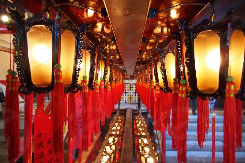 Lanterns. Receding. Red. Glowing. Yellow. China. Temple. Chinese. Ribbon. Mood.  photo