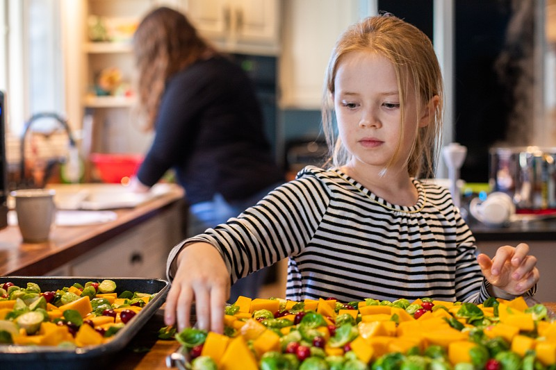 Young girl helping prepare Thanksgiving meal photo