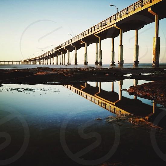 yellow metal river bridge photo