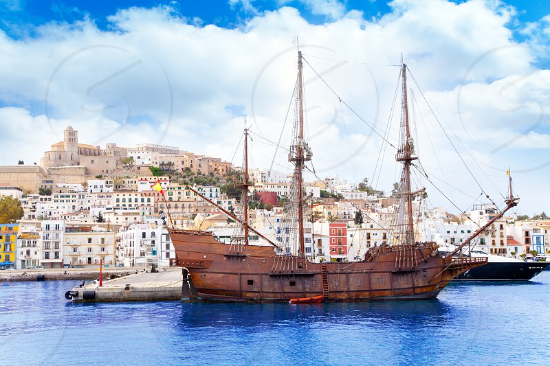 Eivissa ibiza town with old classic wooden corsair boat photo