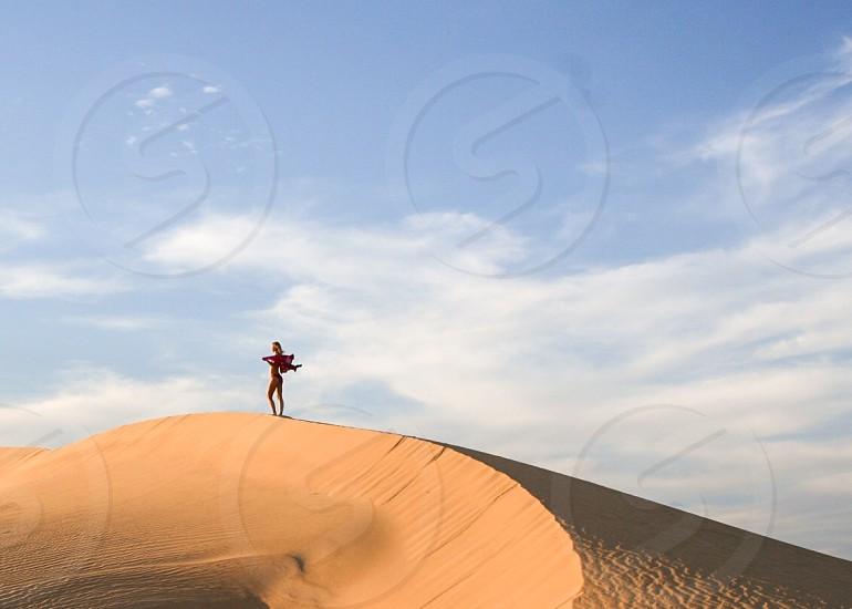 Desert sand dunes remote bikini sun photo