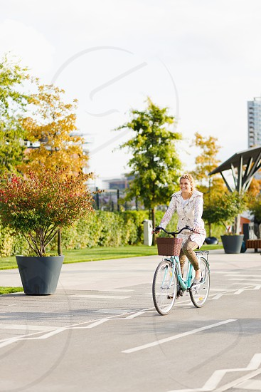 Young woman riding a bicycle in the city photo