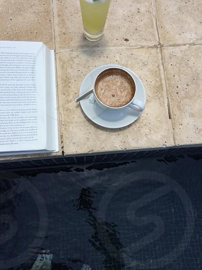 white ceramic mug filled with coffee photo