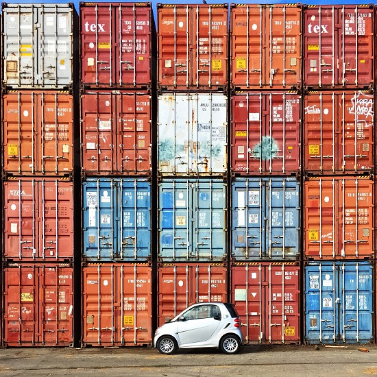 Smartcar in SF in front of shipping containers.  photo
