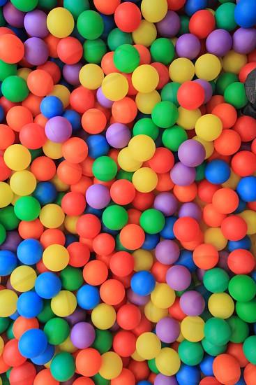 colorful plastic balls in children park background photo