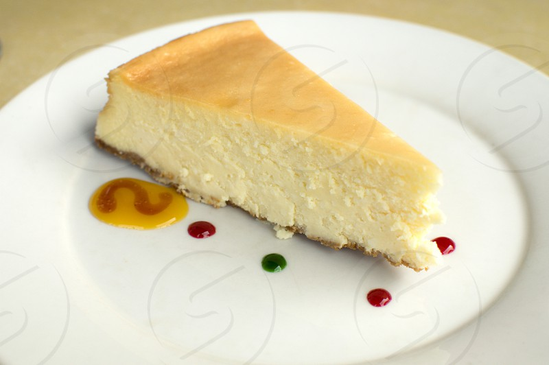 A cheese cake in a white saucer photo
