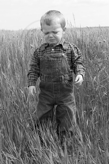 boy wearing overalls crying photo