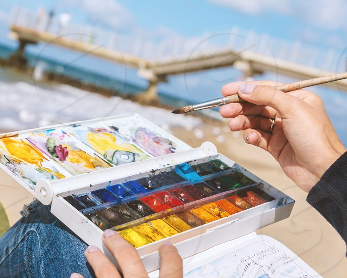 Paint with watercolour on the seashore photo