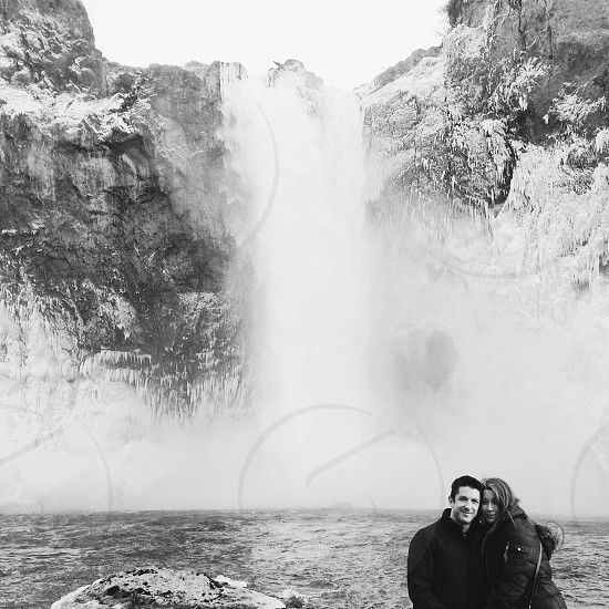 man and woman photo with falls background photo