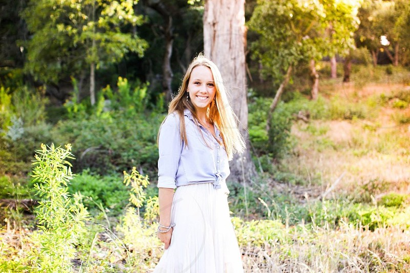 woman wearing white skirt and white long sleeved shirt photo