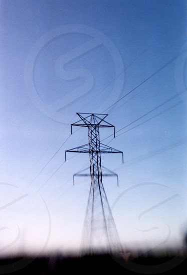 Electricity pylon in the distance photo