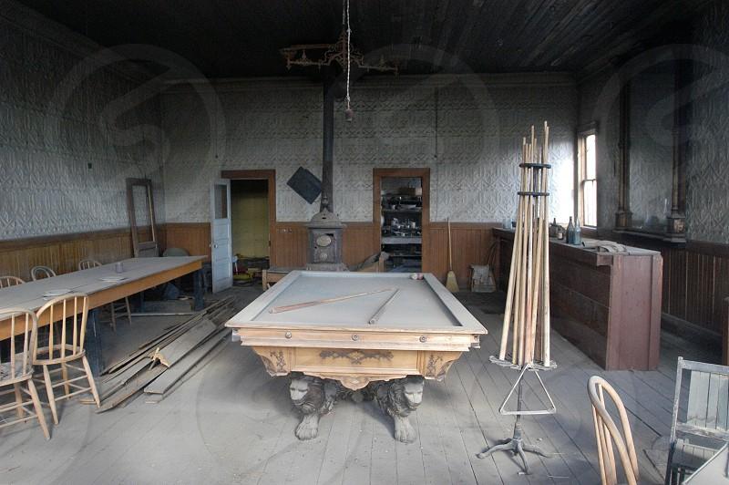 Billiard table. Dust. Abandoned. Pool hall. Saloon. photo
