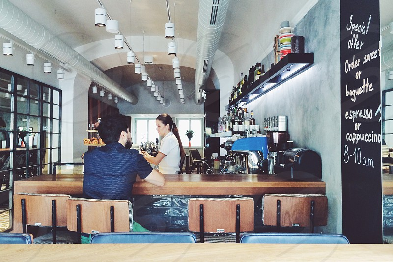 man and woman in coffee shop photo