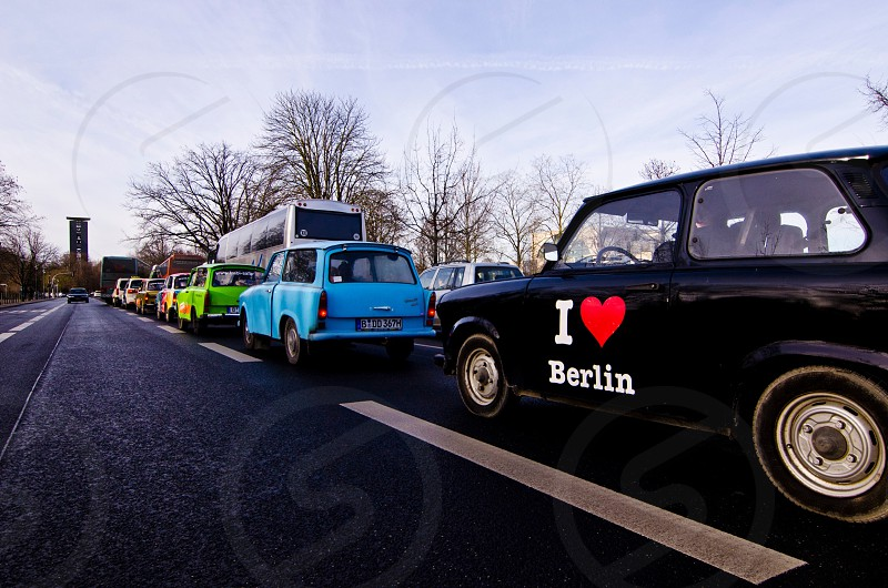 classic hatchbacks lined up on the road photo