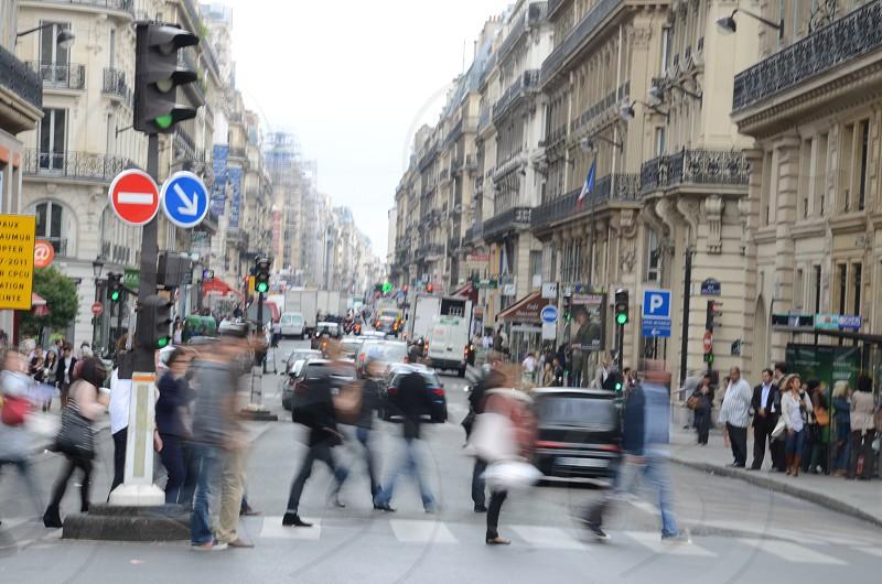 people walking accross the street photo