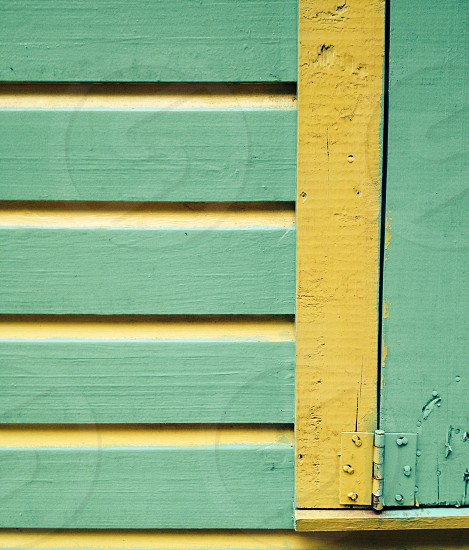 Teal siding and window cover photo